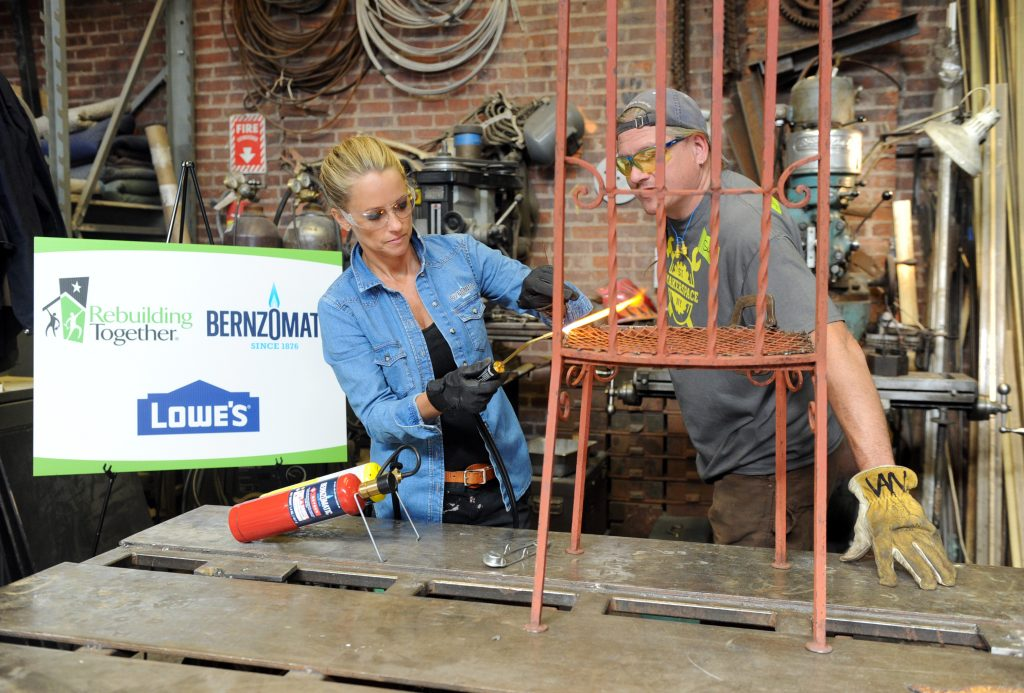 Restoration expert Nicole Curtis and Scott Van Campen, of Staten Island MakerSpace, use Bernzomatic blowtorches to repair salvaged chairs at the launch event for the Bernzomatic Find Your Fire Community Grants program, Thursday, Oct. 22, 2015, in New York. MakerSpace is a community center still feeling the effects of Hurricane Sandy three years later. Bernzomatic, the industry leader in handheld torches, is encouraging people to submit a community project for a chance to win one of three $10,000 grants and a visit from Curtis. Go to Bernzomatic.com/Grants for more information. (Photo by Diane Bondareff/Invision for Bernzomatic/AP Images)